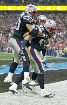 HOUSTON, TX - FEBRUARY 1:  Mike Vrabel # of the New England Patriots and teammates celebrate his one yard touchdown against the defense of the Carolina Panthers in the fourth quarter during Super Bowl XXXVIII at Reliant Stadium on February 1, 2004 in Hous