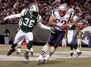 EAST RUTHERFORD, NJ - DECEMBER 26:  Mike Vrabel #50 of the New England Patriots catches his second touchdown as David Barrett #36 of the New York Jets tries to defend during the game on December 26, 2005 at Giants Stadium in East Rutherford, New Jersey.