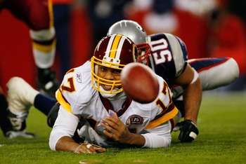 FOXBORO, MA - OCTOBER 28:  Jason Campbell #17 of the Washington Redskins fumbles the ball after he is sacked by Mike Vrabel #50 of the New England Patriots on October 28, 2007 at Gillette Stadium in Foxboro, Massachusetts. The Patriots defeated the Redski