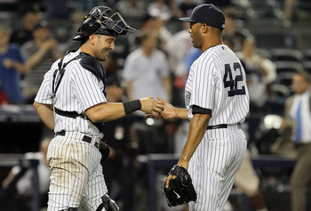Yankees closer Mariano Rivera (right) is congratulated by catcher Francisco Cervelli (left) after picking up the save in a 4-1 win against the Seattle Mariners. The loss for the Mariners pushed their streak to 17 consecutive losses.