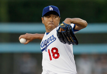 LOS ANGELES, CA - JULY 27:  Hiroki Kuroda #18 of the Los Angeles Dodgers pitches against the Colorado Rockies in the first inning at Dodger Stadium on July 27, 2011 in Los Angeles, California.  (Photo by Jeff Gross/Getty Images)