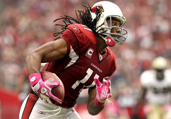 GLENDALE, AZ - OCTOBER 10:  Wide receiver Larry Fitzgerald #11 of the Arizona Cardinals runs with the football after a reception against the New Orleans Saints during the NFL game at the University of Phoenix Stadium on October 10, 2010 in Glendale, Arizo