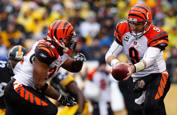 PITTSBURGH - DECEMBER 12:  Carson Palmer #9 hands the ball off to teammate Cedric Benson #32 of the Cincinnati Bengals during the game against the Pittsburgh Steelers on December 12, 2010 at Heinz Field in Pittsburgh, Pennsylvania.  (Photo by Jared Wicker
