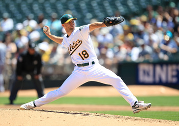 OAKLAND, CA - JULY 28:  Rich Harden #18 of the Oakland Athletics pitches against the Tampa Bay Rays at O.co Coliseum on July 28, 2011 in Oakland, California.  (Photo by Jed Jacobsohn/Getty Images)
