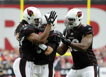 GLENDALE, AZ - OCTOBER 31:  Larry Fitzgerald #11 of the Arizona Cardinals celebrates his touchdown with Max Hall #6 and Calais Campbell #93 against the Tampa Bay Buccaneers during the first quarter at University of Phoenix Stadium on October 31, 2010 in G