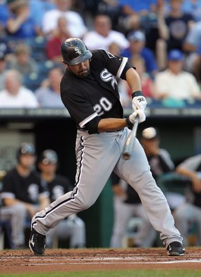 KANSAS CITY, MO - JULY 19:  Carlos Quentin #20 of the Chicago White Sox in action during the game against the Kansas City Royals on July 19, 2011 at Kauffman Stadium in Kansas City, Missouri.  (Photo by Jamie Squire/Getty Images)
