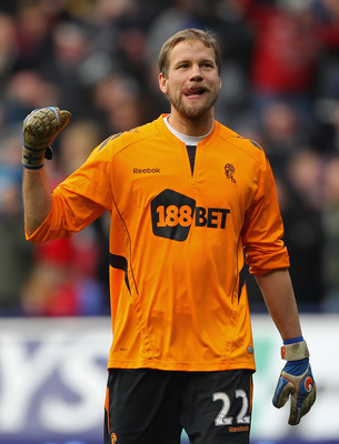 BOLTON, ENGLAND - MARCH 05:  Jussi Jaaskelainen of Bolton Wanderers celebrates after the Barclays Premier League match between Bolton Wanderers and Aston Villa at the Reebok Stadium on March 5, 2011 in Bolton, England.  (Photo by Alex Livesey/Getty Images