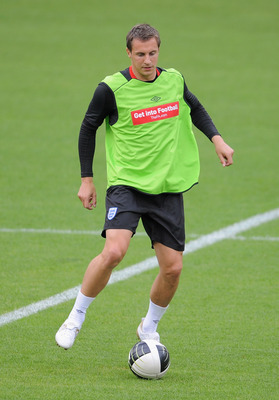 BASEL, SWITZERLAND - SEPTEMBER 06: Phil Jagielka  warms up during the England training session ahead of their UEFA EURO 2012 qualifying match against Switzerland, at the St Jacob Stadium on September 6, 2010 in Basel, Switzerland.  (Photo by Michael Regan
