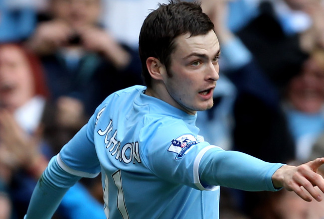 MANCHESTER, ENGLAND - APRIL 03:  Adam Johnson of Manchester City celebrates scoring the opening goal during the Barclays Premier League match between Manchester City and Sunderland at the City of Manchester Stadium on April 3, 2011 in Manchester, England.