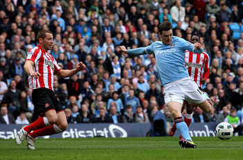 MANCHESTER, ENGLAND - APRIL 03:  Adam Johnson of Manchester City scores the opening goal during the Barclays Premier League match between Manchester City and Sunderland at the City of Manchester Stadium on April 3, 2011 in Manchester, England.  (Photo by