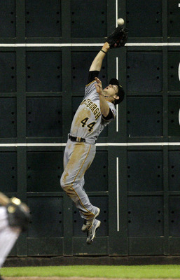 HOUSTON - JULY 15:  Left fielder Alex Presley #44 of the Pittsburgh Pirates makes a leaping catch near the wall against the Houston Astros at Minute Maid Park on July 15, 2011 in Houston, Texas.  (Photo by Bob Levey/Getty Images)