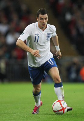 LONDON, ENGLAND - OCTOBER 12:  Adam Johnson of England in action during the UEFA EURO 2012 Group G Qualifying match between England and Montenegro at Wembley Stadium on October 12, 2010 in London, England.  (Photo by Hamish Blair/Getty Images)