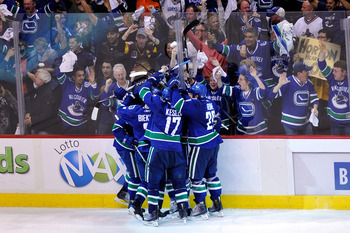 VANCOUVER, BC - JUNE 01:  Raffi Torres #13 of the Vancouver Canucks celebrates with his teammates Victor Oreskovich #38, Kevin Bieksa #3, Ryan Kesler #17 and Aaron Rome #29 after a goal late in the third period against Tim Thomas #30 of the Boston Bruins
