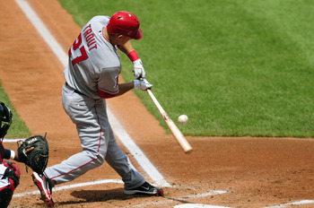 CLEVELAND, OH - JULY 27: Mike Trout #27 of the Los Angeles Angels of Anaheim hits a single during the third inning against the Cleveland Indians at Progressive Field on July 27, 2011 in Cleveland, Ohio. (Photo by Jason Miller/Getty Images)