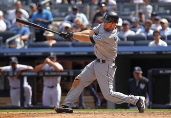 NEW YORK, NY - JULY 27: Dustin Ackley #13 of the Seattle Mariners hits a ground out RBI in the seventh inning against the New York Yankees on July 27, 2011 at Yankee Stadium in the Bronx borough of New York City.  (Photo by Nick Laham/Getty Images)