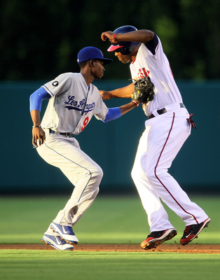 ANAHEIM, CA - JULY 1: Shortstop Dee Gordon #9 of the Los Angeles Dodgers tags out Torii Hunter #48 of the Los Angeles Angels of Anaheim on an attempted stolen base play in the first inning on July 1, 2011 at Angel Stadium in Anaheim, California.   (Photo