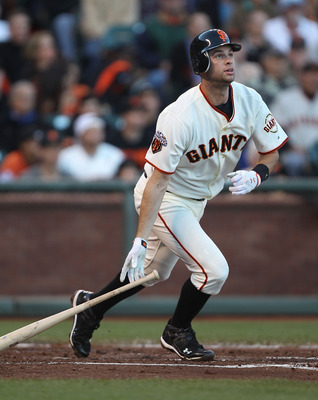 SAN FRANCISCO, CA - JULY 19:  Brandon Belt #9 of the San Francisco Giants hits a solo home run in the second inning against the Los Angeles Dodgers at AT&T Park on July 19, 2011 in San Francisco, California.  (Photo by Jed Jacobsohn/Getty Images)