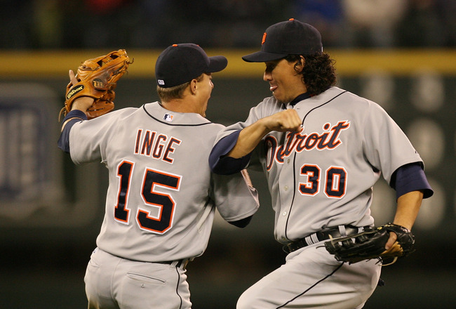 SEATTLE - APRIL 18:  Magglio Ordonez #30 of the Detroit Tigers celebrates with Brandon Inge #15 after defeating the Seattle Mariners 2-0 on April 18, 2009 at Safeco Field in Seattle, Washington. (Photo by Otto Greule Jr/Getty Images)