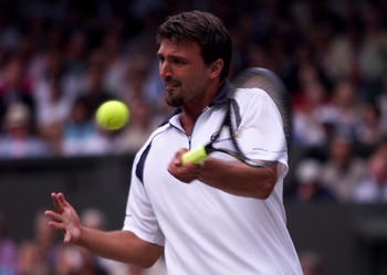 7 Jul 2001:  Goran Ivanisevic of Croatia in action against Tim Henman of Great Britain during the men's semi final's of The All England Lawn Tennis Championship at Wimbledon, London.  DIGITAL IMAGE Mandatory Credit: Gary M. Prior/ALLSPORT
