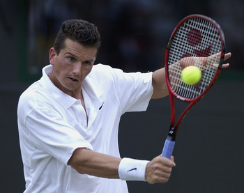 WIMBLEDON - July 2:  Richard Krajicek of the Netherlands in action against Mark Philippoussis of Australia at the All England Tennis Championships at the All England Lawn Tennis Club, Wimbledon, England, on July 2, 2002. (Photo by Clive Brunskill/Getty Im