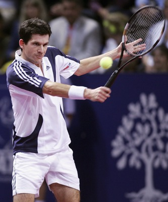 BASEL, SWITZERLAND- OCTOBER 26: Tim Henman returns the Ball to Andy Murray during the Men's singles match as part of the Davidoff Swiss Indoors at the St. Jakobhalle on October 26, 2005 in Basel, Switzerland. (Photo by Patrick Straub/Getty Images)