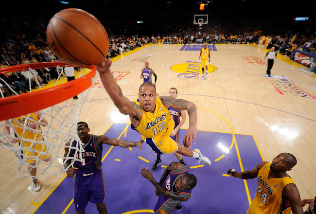 LOS ANGELES, CA - MAY 17:  Guard Shannon Brown #12 of the Los Angeles Lakers goes up for a dunk as guard Jason Richardson #23 of the Phoenix Suns defends in Game One of the Western Conference Finals during the 2010 NBA Playoffs at Staples Center on May 17