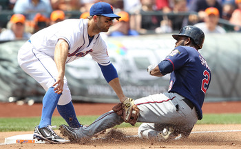 NEW YORK - JUNE 26: Denard Span #2 of the Minnesota Twins is tagged out by David Wright #5 of the New York Mets at Citi Field on June 26, 2010 in the Flushing neighborhood of the Queens borough of New York City.  (Photo by Nick Laham/Getty Images)
