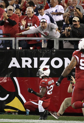 GLENDALE, AZ - DECEMBER 25:  Cornerback Dominique Rodgers-Cromartie #29 of the Arizona Cardinals celebrates after scoring on a touchdown interception against the Dallas Cowboys during the first quarter of the NFL game at the University of Phoenix Stadium