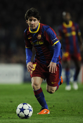 BARCELONA, SPAIN - MARCH 08:  Lionel Messi of FC Barcelona runs with the ball during the UEFA Champions League round of 16 second leg match between Barcelona and Arsenal at the Camp Nou stadium on March 8, 2011 in Barcelona, Spain.  Barcelona won 3-1.  (P