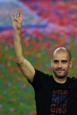 BARCELONA, SPAIN - MAY 29:  Head coach Josep Guardiola of FC Barcelona gestures during the celebrations after winning the UEFA Champions League Final against Manchester United at Camp Nou Stadium on May 29, 2011 in Barcelona, Spain.  (Photo by David Ramos