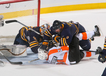 BUFFALO, NY - APRIL 24: Jordan Leopold #3 and Ryan Miller #30 of the Buffalo Sabres defend against James van Riemsdyk #21  of the Philadelphia Flyers in Game Six of the Eastern Conference Quarterfinals during the 2011 NHL Stanley Cup Playoffs at HSBC Aren