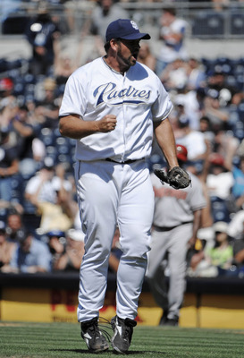 SAN DIEGO, CA - JULY 28: Heath Bell #21 of the San Diego Padres reacts after getting the final during the ninth inning of a baseball game against the Arizona Diamondbacks at Petco Park on July 28, 2011 in San Diego, California. The  Padres won 4-3.  (Phot