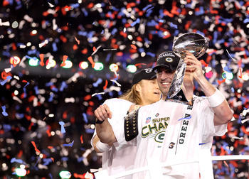 ARLINGTON, TX - FEBRUARY 06:  Super Bowl MVP Aaron Rodgers #12 (R) and Clay Matthews #52 of the Green Bay Packers celebrate with the Lombardi Trophy after winning Super Bowl XLV 31-25 against the Pittsburgh Steelers at Cowboys Stadium on February 6, 2011