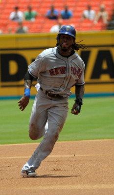 MIAMI GARDENS, FL - JULY 24:  Jose Reyes #7 of the New York Mets runs to third base during a game against the Florida Marlins at Sun Life Stadium on July 24, 2011 in Miami Gardens, Florida.  (Photo by Sarah Glenn/Getty Images)