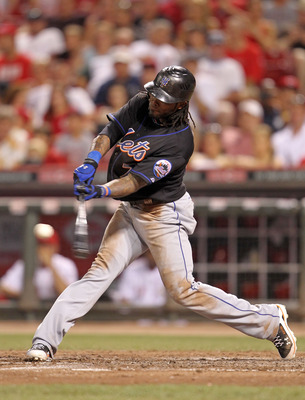 CINCINNATI, OH - JULY 27:  Jose Reyes #7 of the New York Mets hits a double during the game against the Cincinnati Reds at Great American Ball Park on July 27, 2011 in Cincinnati, Ohio.  (Photo by Andy Lyons/Getty Images)