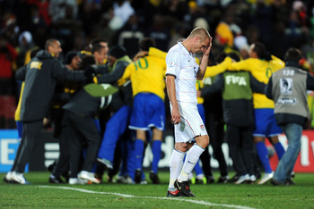 JOHANNESBURG, SOUTH AFRICA - JUNE 28:  Jay DeMerit of USA shows his dejection as Brazil celebrate victory at the end of the FIFA Confederations Cup Final between USA and Brazil at the Ellis Park Stadium on June 28, 2009 in Johannesburg, South Africa.  (Ph