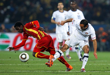 RUSTENBURG, SOUTH AFRICA - JUNE 26: Landon Donovan of the United States tackles Anthony Annan of Ghana during the 2010 FIFA World Cup South Africa Round of Sixteen match between USA and Ghana at Royal Bafokeng Stadium on June 26, 2010 in Rustenburg, South