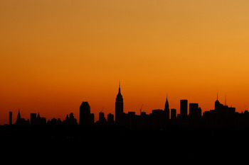 NEW YORK - SEPTEMBER 01:  The sunsets over the Manhattan skyline during day two of the 2009 U.S. Open at the USTA Billie Jean King National Tennis Center on September 1, 2009 in Flushing neighborhood of the Queens borough of New York City.  (Photo by Juli