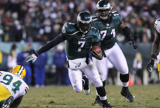 PHILADELPHIA, PA - JANUARY 09:  Michael Vick #7 of the Philadelphia Eagles runs down field against Jarius Wynn #94 of the Green Bay Packers during the 2011 NFC wild card playoff game at Lincoln Financial Field on January 9, 2011 in Philadelphia, Pennsylva