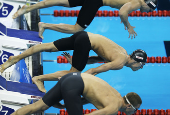 SHANGHAI, CHINA - JULY 29:  Michael Phelps of the United States(C)  competes in the Men's 100m Butterfly semi final during Day Fourteen of the 14th FINA World Championships at the Oriental Sports Center on July 29, 2011 in Shanghai, China.  (Photo by Ezra
