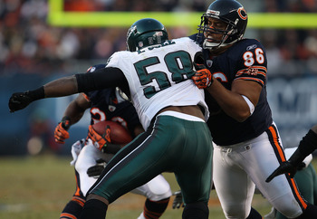 CHICAGO - NOVEMBER 28: Brandon Manumaleuna #86 of the Chicago Bears blocks Trent Cole #58 of the Philadelphia Eagles at Soldier Field on November 28, 2010 in Chicago, Illinois. The Bears defeated the Eagles 31-26. (Photo by Jonathan Daniel/Getty Images)