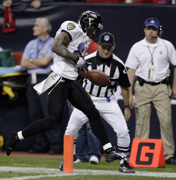HOUSTON, TX - DECEMBER 13: Wide receiver Derrick Mason #85 of the Baltimore Ravens scores his second toudhdown of the quarter against the Houston Texans at Reliant Stadium on December 13, 2010 in Houston, Texas.  (Photo by Bob Levey/Getty Images)