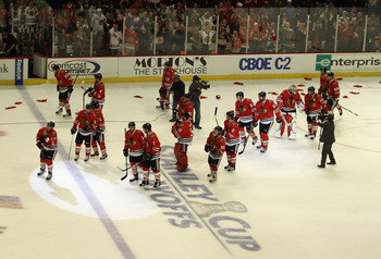 CHICAGO, IL - APRIL 24: Members of the Chicago Blackhawks celebrate a win over the Vancouver Canucks in Game Six of the Western Conference Quarterfinals during the 2011 NHL Stanley Cup Playoffs at the United Center on April 24, 2011 in Chicago, Illinois.