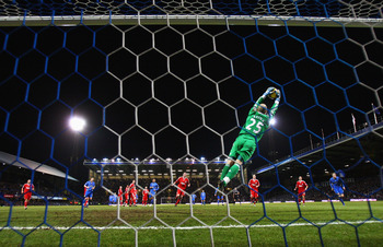 PORTSMOUTH, UNITED KINGDOM - FEBRUARY 07: Goalkeeper Pepe Reina of Liverpool makes a save during the Barclays Premier League match between Portsmouth and Liverpool at Fratton Park on February 7, 2009 in Portsmouth, England.  (Photo by Mike Hewitt/Getty Im