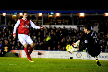 BIRMINGHAM, ENGLAND - JANUARY 01: Robin van Persie of Arsenal has his shot on goal saved by Ben Foster the Birmingham goalkeeper during the Barclays Premier Leaue match between Birmingham City and Arsenal at St. Andrews on January 1, 2011 in Birmingham, E