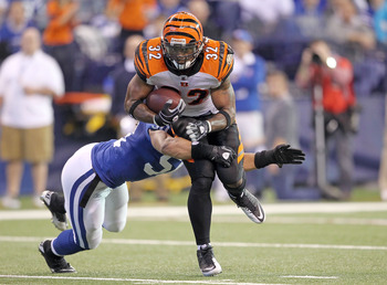 INDIANAPOLIS - NOVEMBER 14:  Cedric Benson #32 of the Cincinnati Bengals runs with the ball while defended by Phillip Wheeler #50 of the Indianapolis Colts during the NFL game at Lucas Oil Stadium on November 14, 2010 in Indianapolis, Indiana.  (Photo by
