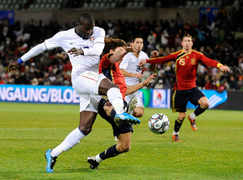 BLOEMFONTEIN, SOUTH AFRICA - JUNE 24: Jozy Altidore #17 of USA takes a shot on goal against Carles Puyol #5 of Spain during the FIFA Confederations Cup Semi Final match between Spain and USA at the Free State Stadium on June 24, 2009 in Bloemfontein, Sout