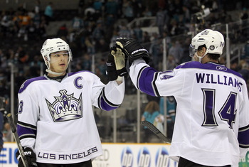 SAN JOSE, CA - APRIL 23:  Dustin Brown #23 and Justin Williams #14 of the Los Angeles Kings celebrate after they beat the San Jose Sharks in game five of the Western Conference Quarterfinals during the 2011 NHL Stanley Cup Playoffs at HP Pavilion on April