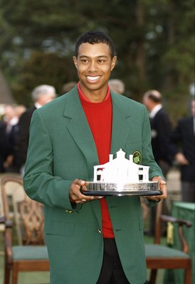 13 Apr 1997:  Tigers Woods wears his green jacket and holds his trophy at the Masters Tournament at the Augusta National Golf Course in Augusta, Georgia. Mandatory Credit: Steve Munday  /Allsport