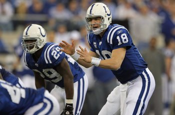 INDIANAPOLIS - JANUARY 13:  Peyton Manning #18 of the Indianapolis Colts calls signals out of the shotgun formation next to Joseph Addai #29 against the San Diego Chargers during their AFC Divisional Playoff game at the RCA Dome on January 13, 2008 in Ind